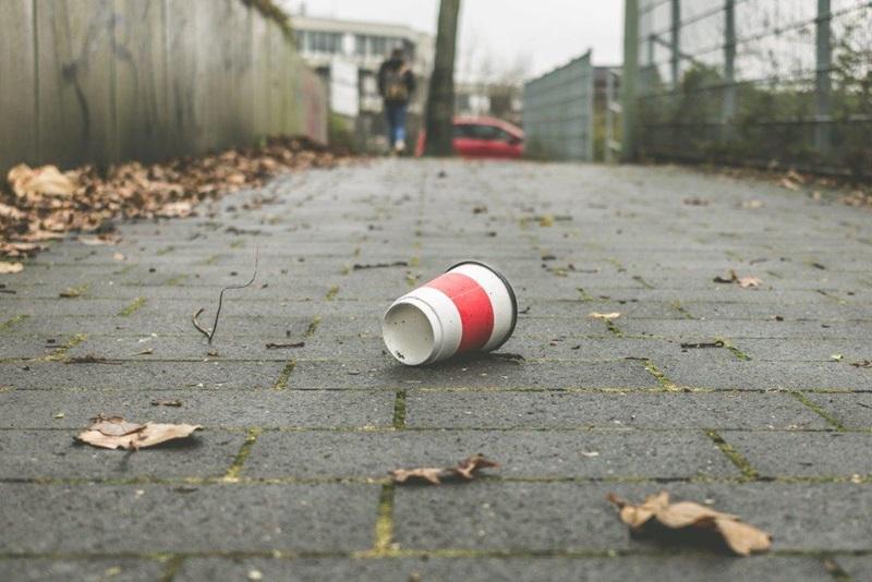 coffee cup on sidewalk