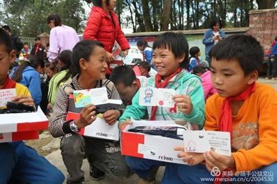 Children receiving shoes